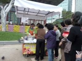 """Ladies queuing for """"chrysanthemum bread"""""""