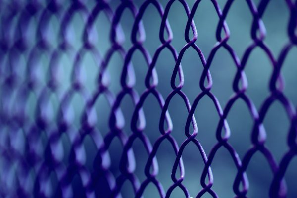 A perimeter fence to indicate the importance of network security barriers in cyberspace
