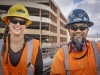 Head and shoulders portrait of a male and female conctruction worker