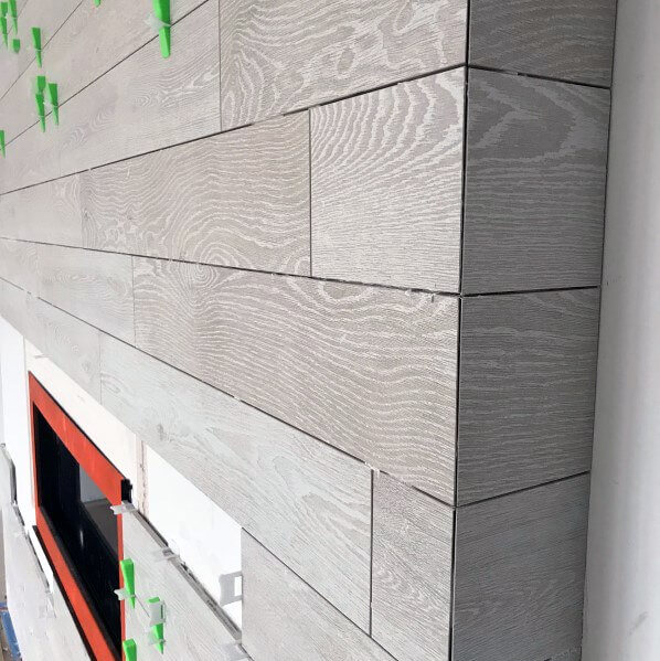 wood look tiles for a cozy fireplace