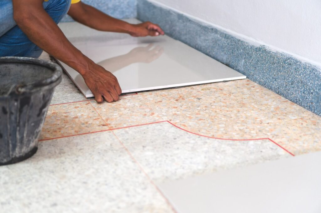 laying tile over vinyl should you do
