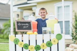 Small boy with a lemonade stand