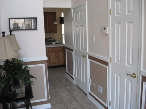 two story foyer with custom trim and paint :: The powder room door in discussion -- 2nd door on the right