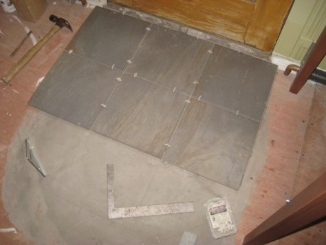Installing a Tile Landing :: tile landing leveler working lines and spacers Use working lines, a square and spacers
