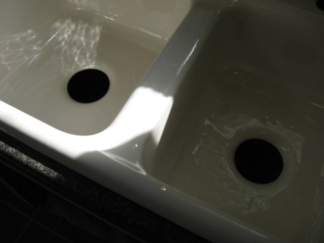 Installing a Self Rimming Sink :: drain holes and handholds in cast iron sink artistic