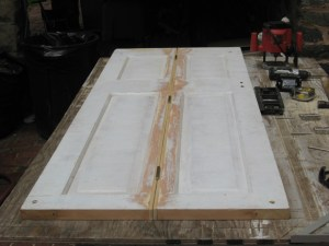 making a bi-fold from a salvaged 4-panel door center hinges installed :: Some light passing thru -- mortise a little deeper