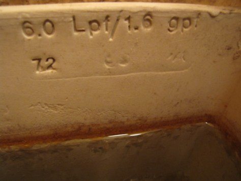 6 Liters aka 1.6 gallons per flush stamped on inside of toilet tank