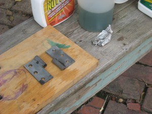 Shutter hinges after a little time in a rust removal bath :: Removing Rust from Hardware :: Rust Bath for Hinges