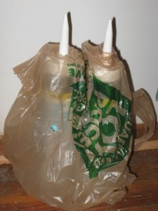 problem caulk tubes poking thru a home center plastic bag