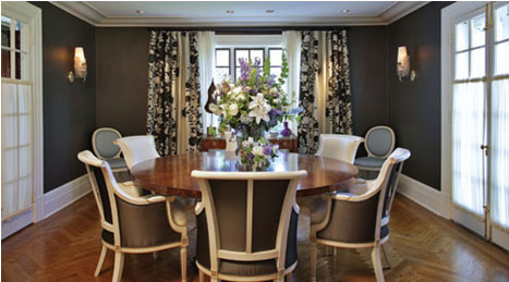 dining room herringbone oak table highlighted by ivory and charcoal silk fabric chairs