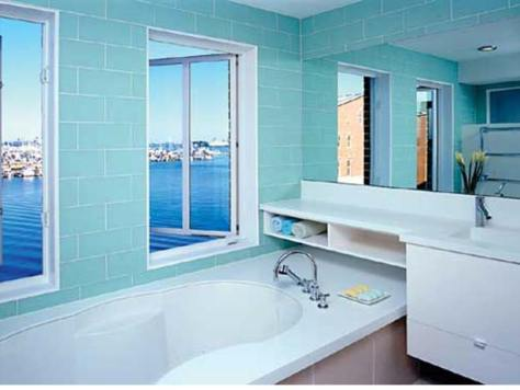 Baltimore Remodel :: bathtub, adorned with sea foam tile overlooks Baltimore's Inner Harbor