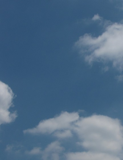 a lightly clouded blue sky image by Barry Morgan
