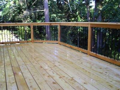 large empty cedar deck weathered image via Ricks Fencing