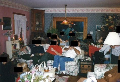 Family in a dated interior with blacked out faces :: source unknown
