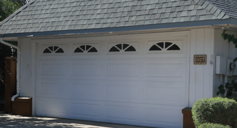Garage Door White 16 panel Sunbursts image via A1 Garage Door Service