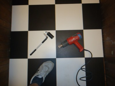 J Roller Heat Gun Used with Checkerboard Vinyl Tile Install