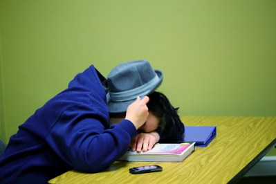 College Student Sleeping on Desk