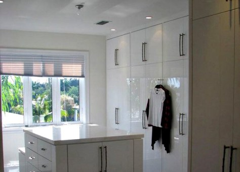 large walk in closet white lacquered cabinetry natural light