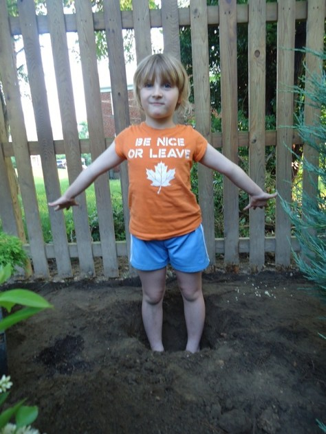 Little Girl in Plant Hole