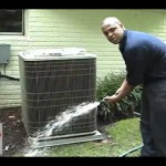 Cleaning an air conditioner compressor