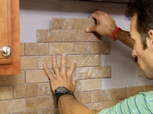 installing a backsplash for the kitchen viahttp://www.architecturalarttile.com