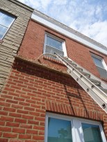 Ladder with Ladder Support 2nd Story Window Brick