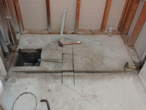 Removing old shower drain cutting for inline