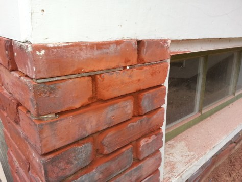 steel shims installed in a brick pier