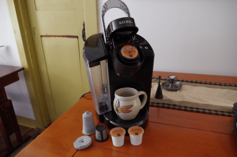 Image of a Keurig single serve coffee maker, with pre-packaged and reusable pods.