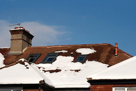 Spring Home Repair :: snow covered roof and damage to the chimney