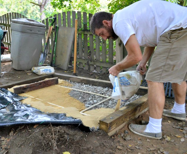 pouring sand over pvc grid