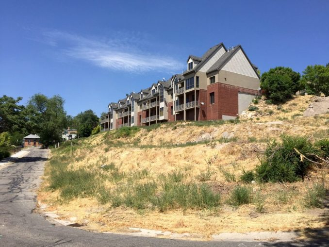 The sloped 1.39 acre lot near 200 North and West Temple is the site of the proposed Almond Street Townhomes. Photo by Isaac Riddle.
