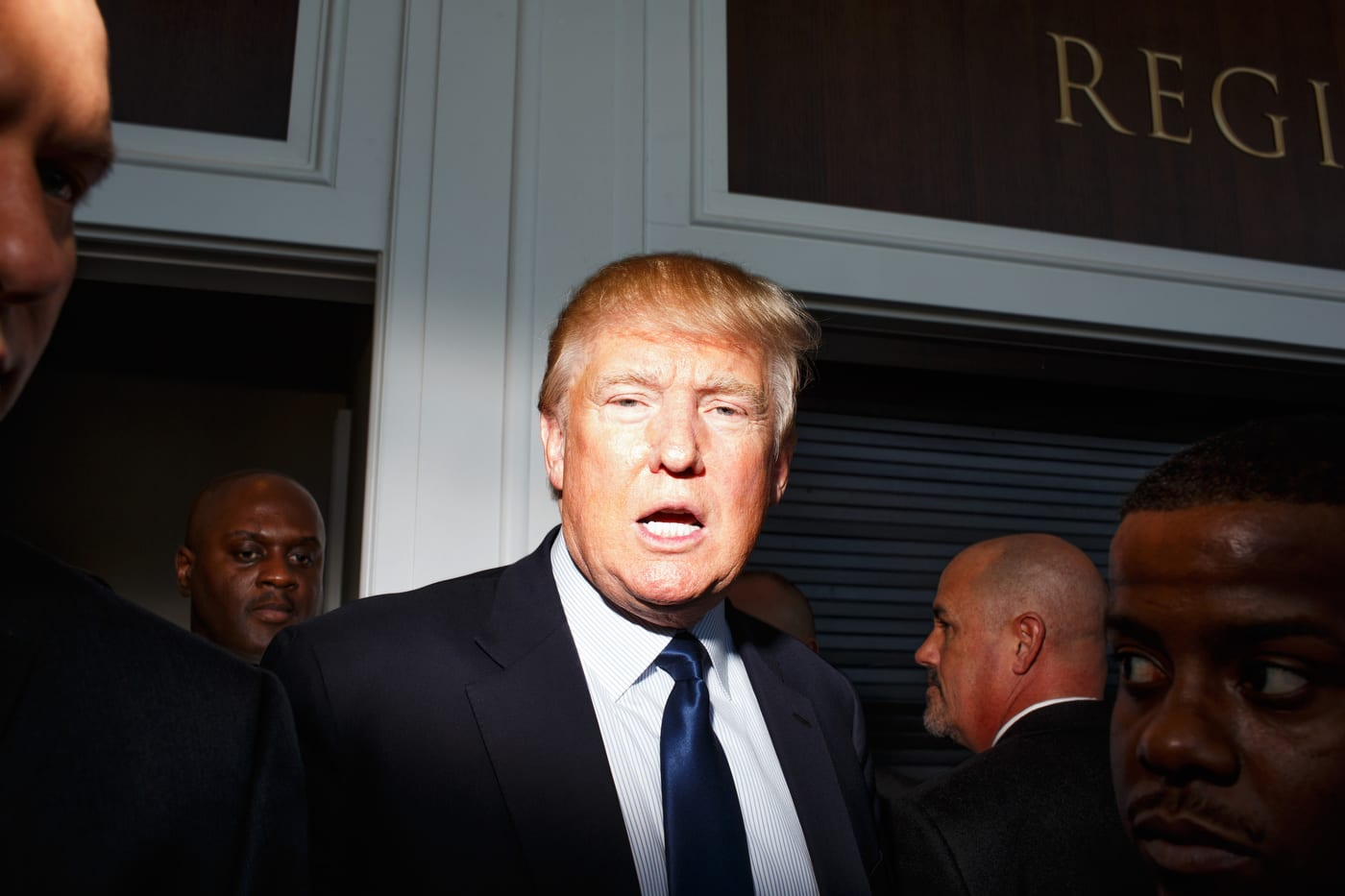 Donald Trump, surrounded by security, makes his way to a series of media interviews at CPAC in National Harbor, MD on Friday, February 27, 2015.