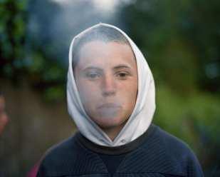 Lenny blowing smoke, Berman Steps, Cobh, Ireland, 2009 © Doug DuBois