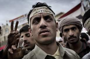 SANAA YEMEN MAY16 2011: A blind protester attends a demonstration at Change Square in Sana'a. ©Yuri Kozyrev
