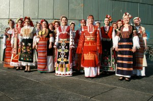 The Bulgarian State Television Female Vocal Choir is an internationally renowned World Music ensemble that performs modern arrangements of traditional melodies. It is most recognized under their contribution to Marcel Cellier's Le Mystère des Voix Bulgares project.The group has since performed extensively around the world to wide acclaim and were honored with a Grammy Award in 1990 for their second album. Their folk costumes are made of natural materials or some materials that are very close to that point. And the important is that they are hand made including the embroidering. The costumes included: Riza (shirt), Sukman (tunica kind of dress), Prestilka (apron), Karpa za glava (kerchief), Karpa v raka (hand kerchief), Mente (sleeveless long jacket), Benevretzi (trousers), Kalpak (fur hat).