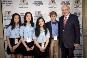 Krystal Graylin, Kei Chua Allyson Graylin (the group winners) and Jake Johnson (the individual winner) stand with Warren Buffett at the Marriott Hotel in Omaha, Nebraska, in this undated handout photo courtesy of Eric Francis photography