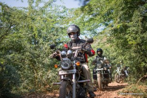 Bulleteer Puneet Singh makes his way through the narrow path laid with rough gravel and covered with babool trees, while on the way back from tighra dam