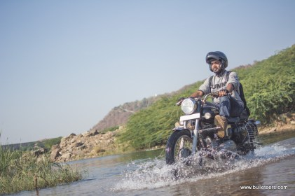 bulleteer Akhil Garg making his way through the water crossing. This narrow river is actually water seeping from the cracks in the dam
