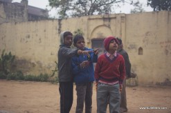 Kids reacting to the entry of motorcycles in Holipura