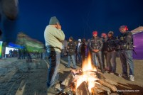 Riders huddled around the numerous bon fires at the rider mania 2015