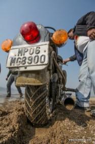 A Royal Enfield Desert Storm stuck in wet sand