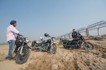 A Harley Davidson Street 750 keeping up with the pack through dirt tracks and sand