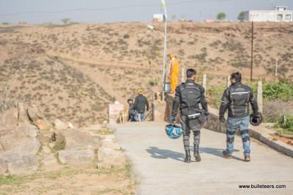 mragendra chaturvedi and mayank sethi walking down to the waterfall