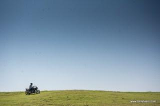 bulleteer akash jain riding a hero karizma atop a hill in the grasslands of pagara