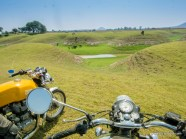 two bulleteers atop their royal enfield classic 500 and continental gt in the grasslands of pagara