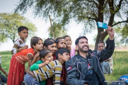 mragendra chaturvedi posing with kids of pagara, during the bulleteer's ride to pagara dam, gwalior