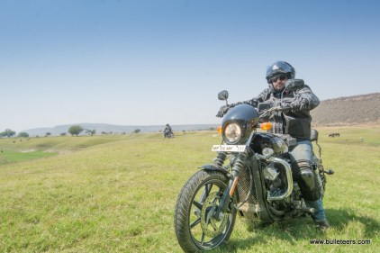 mayank sethi on harley davidson street 750 posing in the grasslands of pagara, gwalior