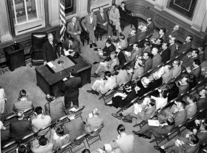 President Truman presides at one of his weekly press conferences in May 1950