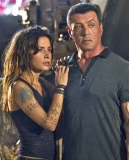 "(L-r) SARAH SHAHI as Lisa and SYLVESTER STALLONE as Jimmy in Warner Bros. Pictures', Dark Castle Entertainment's and IM Global's action thriller ""BULLET TO THE HEAD,"" a Warner Bros. Pictures release."
